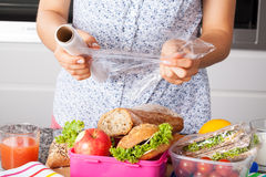 Packing food for lunch Royalty Free Stock Photos