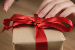 Packing gift box with red ribbon Stock Image