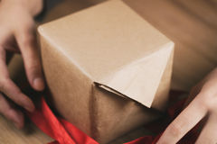 Packing gift box with red ribbon Royalty Free Stock Photography