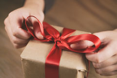 Packing gift box with red ribbon Royalty Free Stock Image