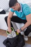 Packing gym bag before training Royalty Free Stock Images