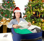 Packing his clothes Royalty Free Stock Image