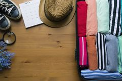 Packing a luggage for a new journey and travel. For a long weekend Stock Image