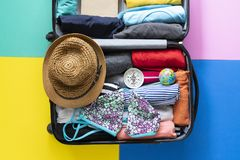 Packing a luggage for a new journey and travel Royalty Free Stock Images