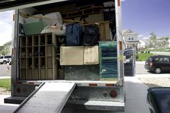 Packing and Moving. Packing up the box truck with household belongings, ready to travel and move Stock Photography