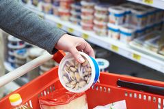Packing of mussels in hand at grocery store. Packing of mussels in the hand of the buyer at the grocery store Stock Photo