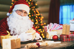Packing presents for Christmas Royalty Free Stock Photo
