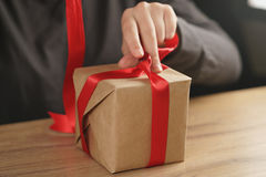 Packing presents with red ribbon Stock Photos
