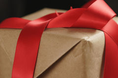 Packing presents with red ribbon Royalty Free Stock Photos
