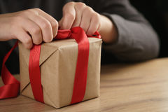 Packing presents with red ribbon Royalty Free Stock Photography