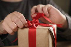Packing presents with red ribbon Stock Image