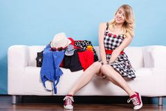 Woman choosing things to pack into suitcase royalty free stock images