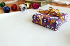 Packing purple christmas gift package with ribbon. Photo of packing purple christmas gift package with ribbon royalty free stock photos