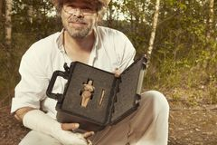 Safety package of archeological finds on field location. Packing of rare votive woman statue and other artifacts on archeological site stock image