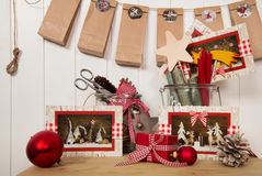 Packing red christmas presents and making or tinker advent calen Royalty Free Stock Images
