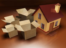 Packing, storage and moving next to a house Royalty Free Stock Photo