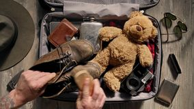 Packing suitcase before adventure travel stock footage