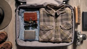 Packing suitcase before adventure travel stock video