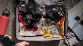 Packing suitcase before adventure travel stock video footage