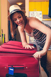 Packing Suitcase And Getting Ready For Traveling Stock Image