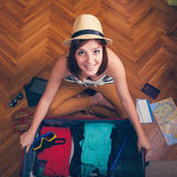 Packing Suitcase And Getting Ready For Traveling Stock Photos