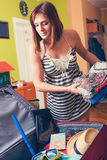 Packing Suitcase And Getting Ready For Traveling Stock Photo