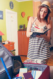 Packing Suitcase And Getting Ready For Traveling Royalty Free Stock Image