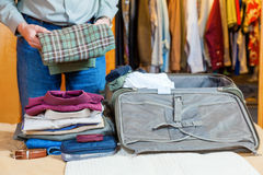 Packing suitcase Stock Image
