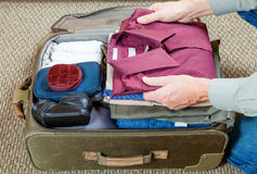 Packing suitcase Stock Images