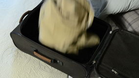 Packing suitcase Royalty Free Stock Photos