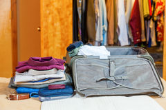Packing suitcase Stock Photography