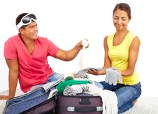 Packing suitcase Stock Photos