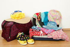 Packing the suitcase for summer vacation. Stock Image