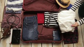 Packing a suitcase for a trip stock video