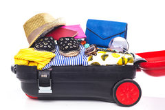 Packing suitcase for trip Stock Photography