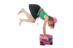 Packing the suitcase. Young woman is packing the suitcase for holidays Royalty Free Stock Photos