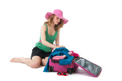 Packing the suitcase by a young woman Stock Photography