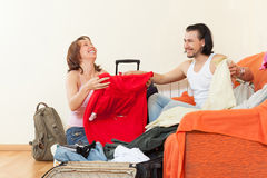 Packing suitcases at home going into an extended vacation Stock Images