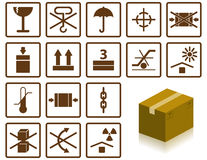Packing symbols. Sixteen packing symbols and cardboard box Royalty Free Stock Photo