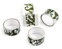 Packing tape with print. Masking tape for gift wrapping. Camouflage print on the packaging adhesive tape. Flexible packaging. Three rolls of duct tape with print Royalty Free Stock Photo