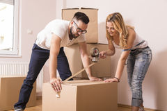Packing and taping the boxes Royalty Free Stock Image