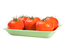 Packing tomatoes Royalty Free Stock Image