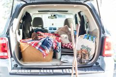 Packing the car for a weekend adventure. Packing the trunk for an active adventure - weekend road trip royalty free stock image