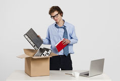 Packing up. Young man in the office packing up after being fired Stock Photo
