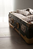 Packing a vintage suitcase Royalty Free Stock Photo