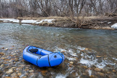 Packraft on a river stock images