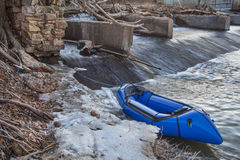 Packraft and river dam. A packraft (one-person light raft used for expedition or adventure racing) below a diversion dam - Cache la Poudre River, Fort Collins royalty free stock images