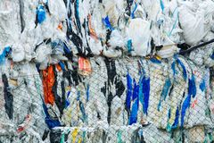 Free Packs And Stocks Of Wrapped Scrap Plastic Dedicated For Eco Recycling In Front Of A Recycling Factory Royalty Free Stock Image - 117021786