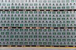 Packs of bottled beer in an outdoor storage lot Stock Images
