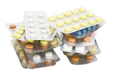 Packs of colored pills Stock Photo